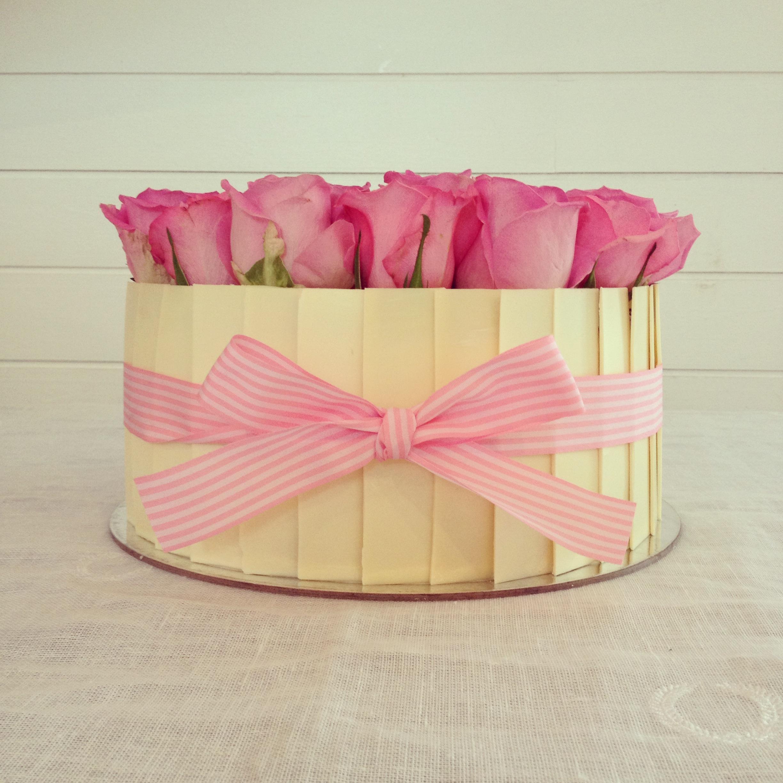 Carrot & pecan gourmet cake with fresh roses
